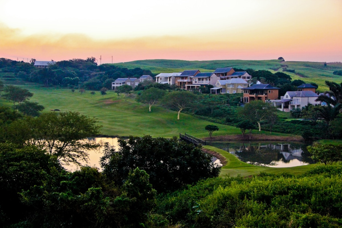 Panoramic view of the 6th fairway, dam and green with African Dream pictured here (terracotta colour).