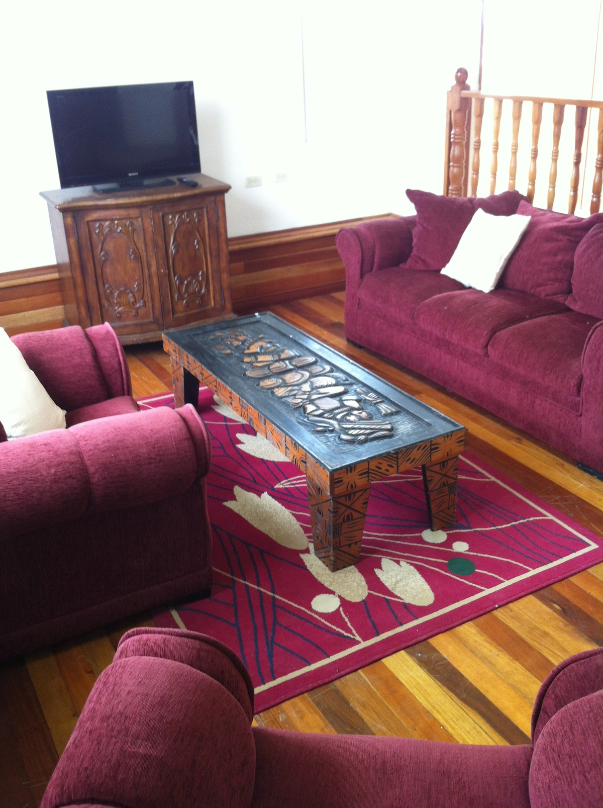 Spacious Great Room Seating Area w/comfy seating and Hardwood Flooring made with Exotic Local Wood