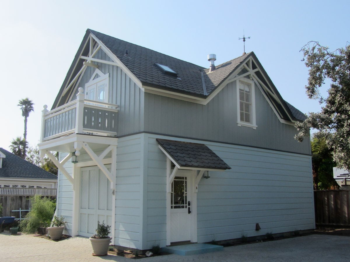 Exterior of carriage house; balcony offers partial ocean view