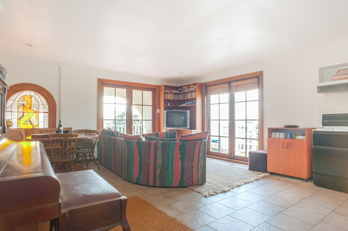 Your living area with lounge, TV, DVD and free wifi laptop. Opens up to your two balcony's through the double french doors with views to the beach and ocean.