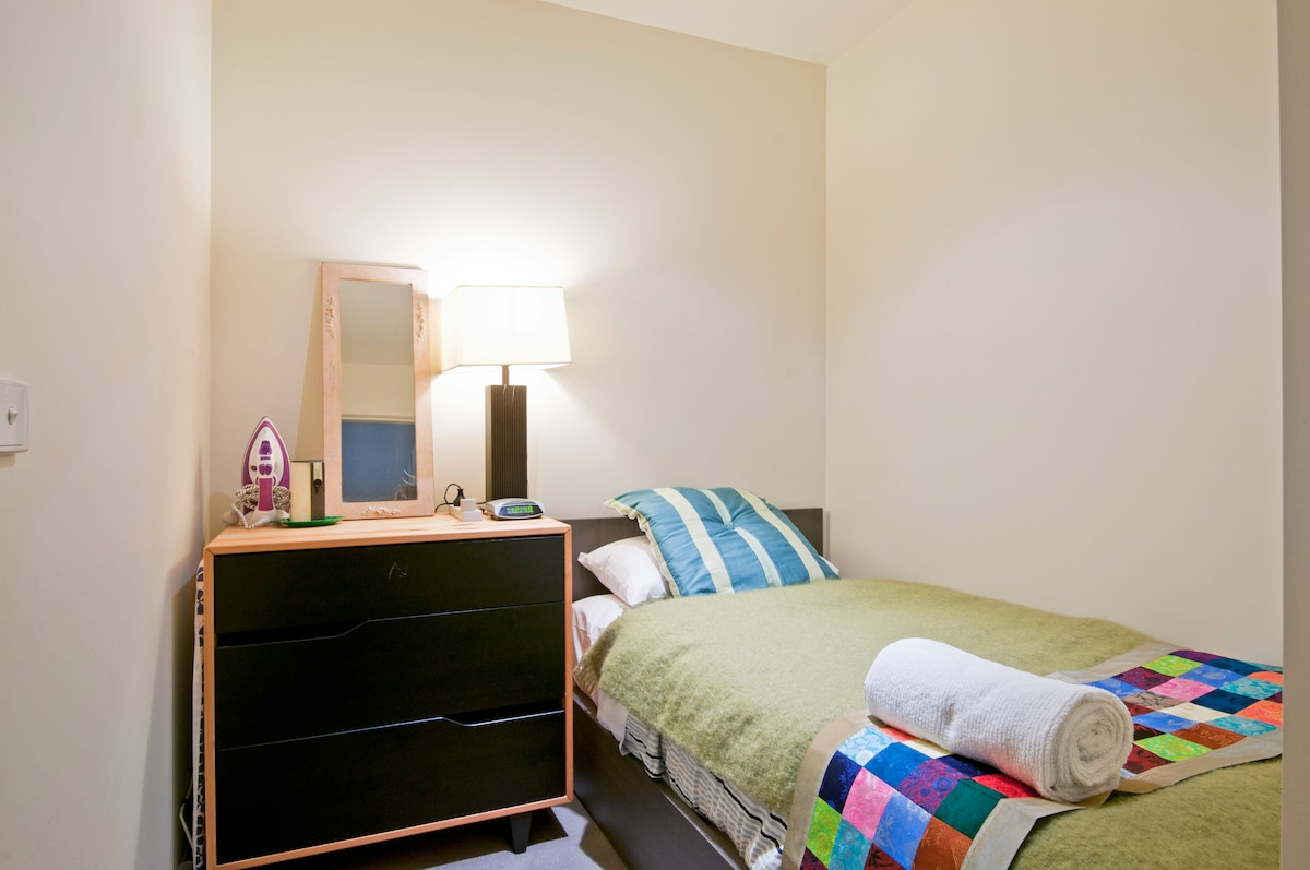 Guest bedroom with all necessities provided.