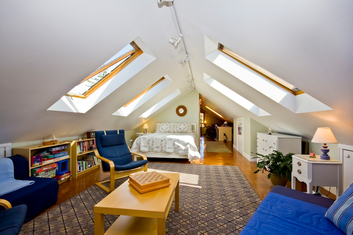 Spacious loft stretches out to include separate sitting area, private bath and exercise bike!