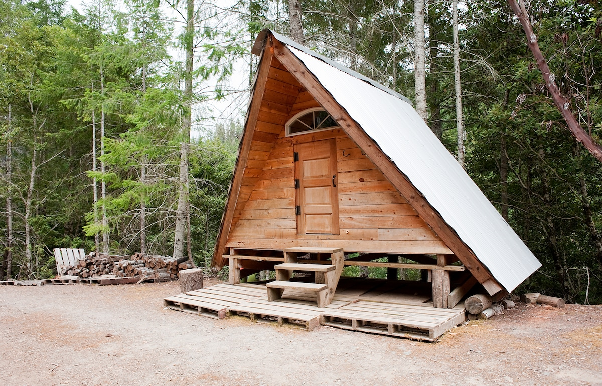 A frame rustic off grid cabin in gasquet for Framing a small cabin