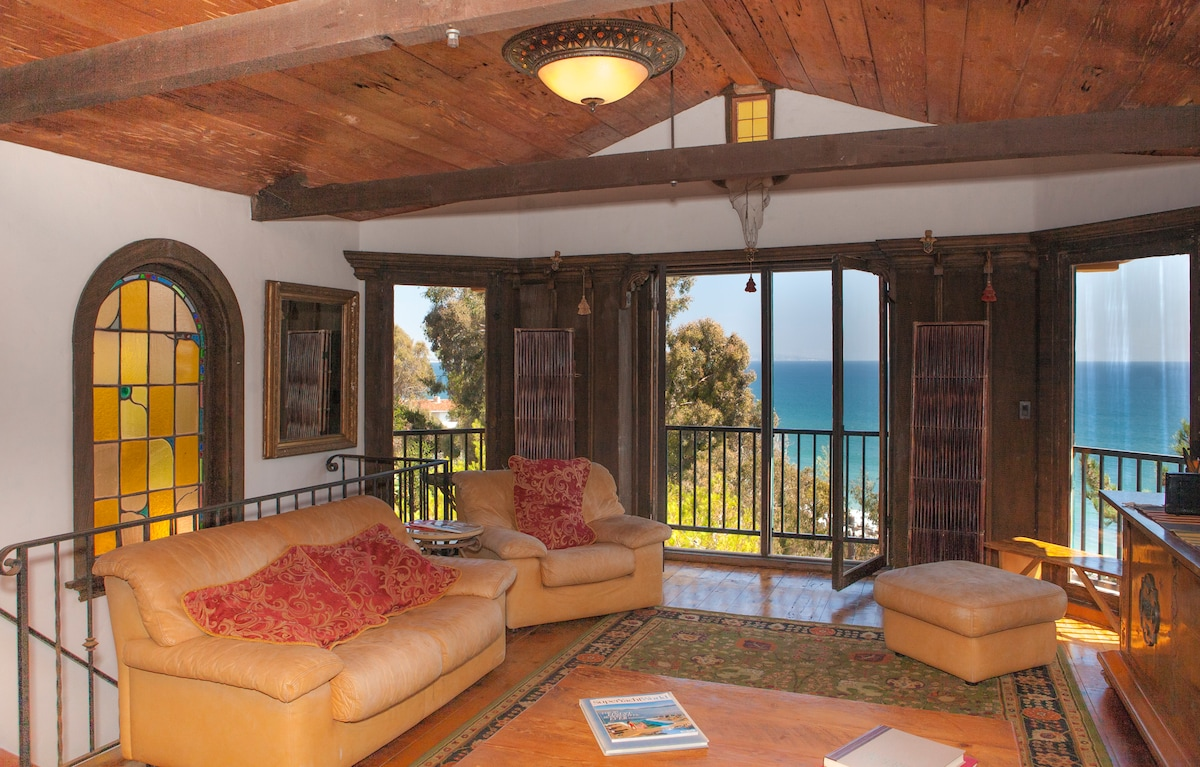 Living room with stunning 180 degree ocean views.