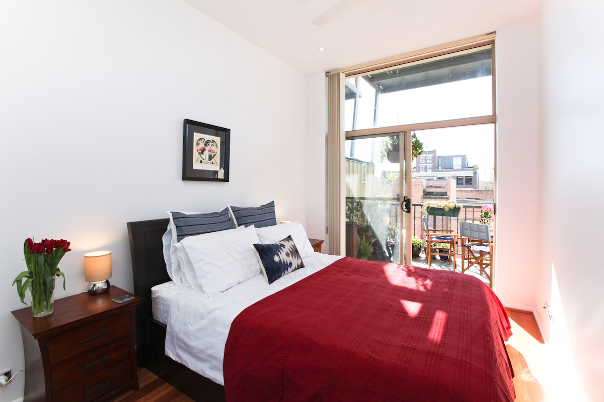 Expansive city views right from the comfortable bed, opens onto large sunny balcony