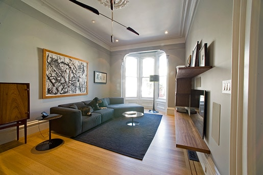 Living room with bay windows looking onto Liberty Street