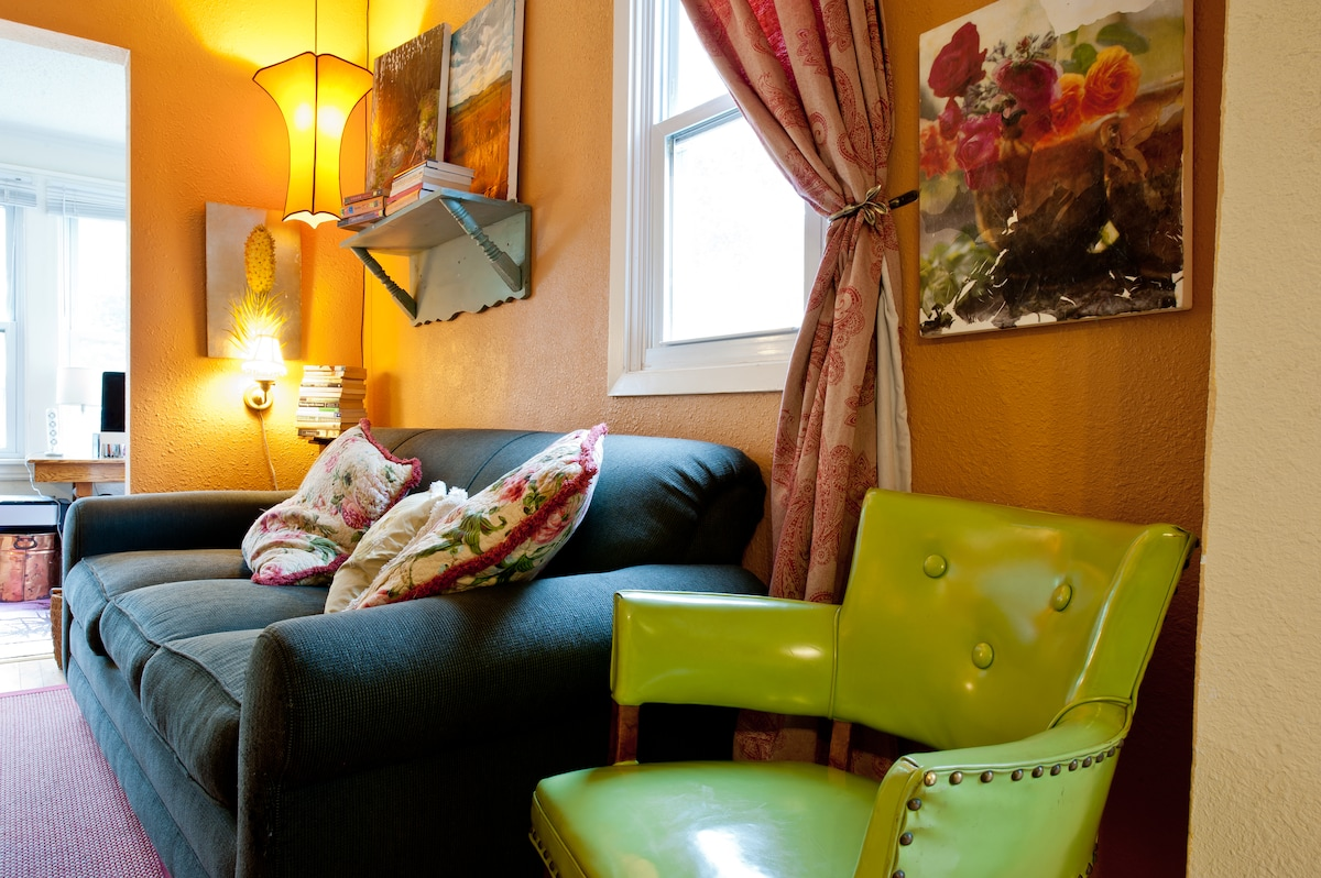 Cheery, Eclectic Living Room - filled with some of my own painted artwork.