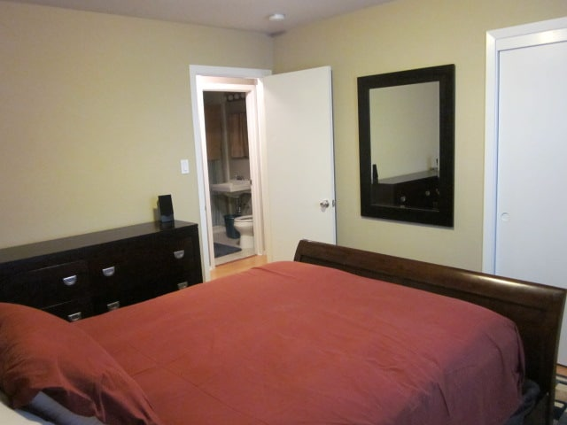 The bedroom is adjacent to the guest bathroom.
