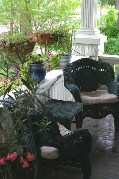 Enjoy the covered porch over looking the flowers and plants in the cottage garden.