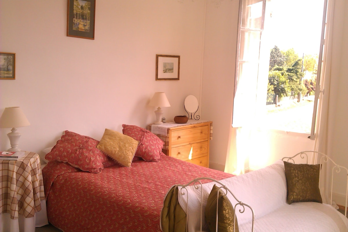 Large double bedroom, showing one of the large traditional shuttered windows. The bedroom has its own washstand unit with fitted basin.