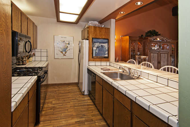 Modern kitchen amenities include stove, oven, refrigerator and freezer, toaster, coffee maker and dishwasher.