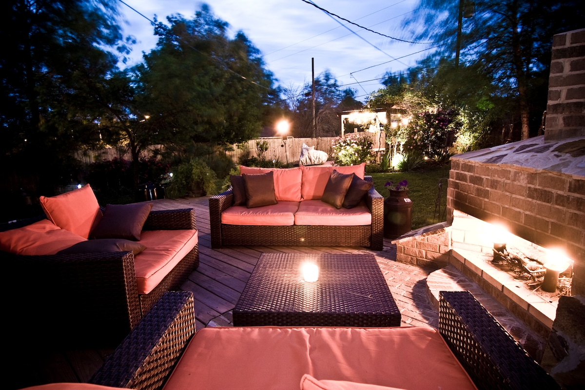 The back garden sitting area and fire