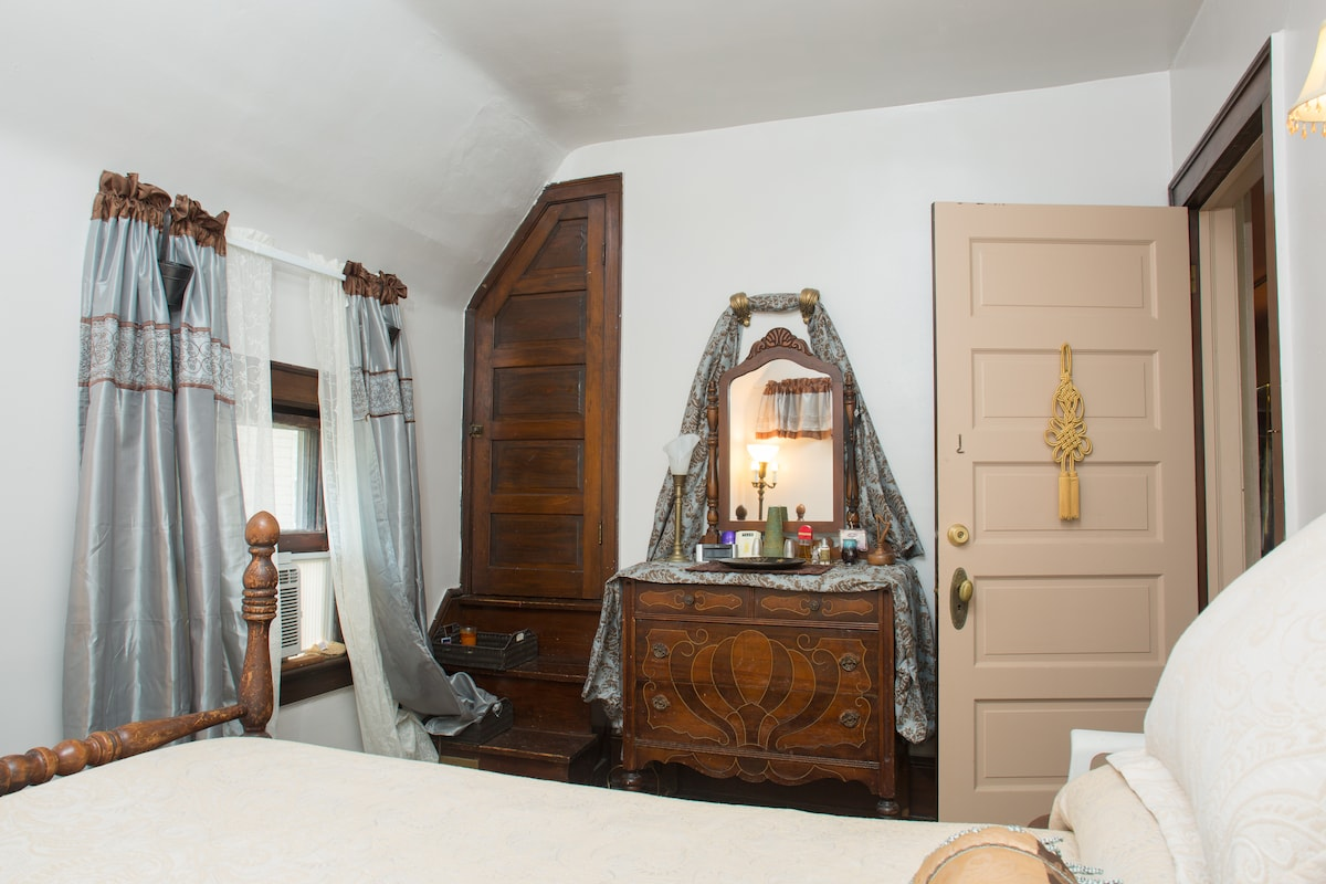 1 of 3 bedrooms on the 2nd fl.  with double bed.  cute walk up closet -grandmas bedroom set from the 20's