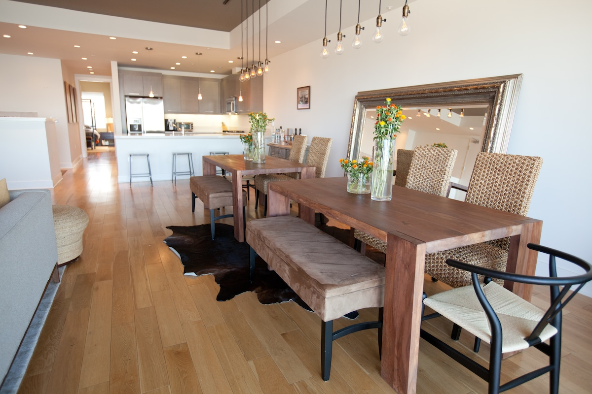 Two dining tables accommodate up to 10 guests. Great for a children's & adult's table or pull them together.