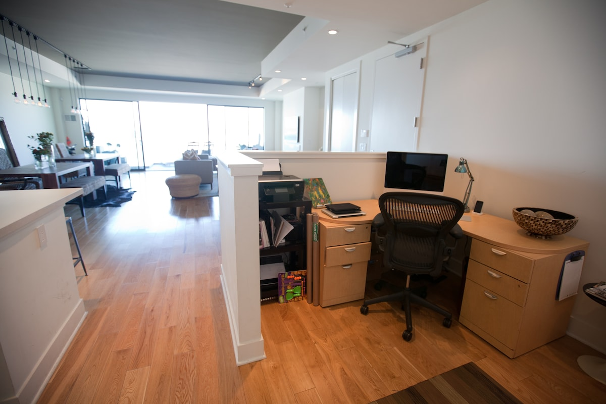 A small office space with an iMac for your use.