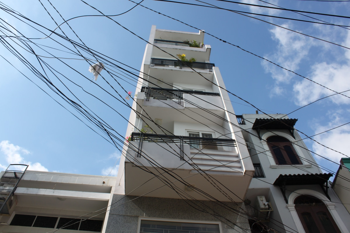 the tallest house in the alley