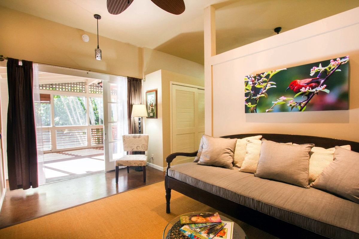 The view from the living room shows the 9' sliding door opening to the large screened porch.