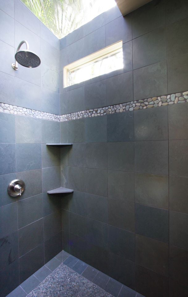 Walk in shower of honed slate, with a large rain-shower head and large skylight.....almost like showering outdoors!