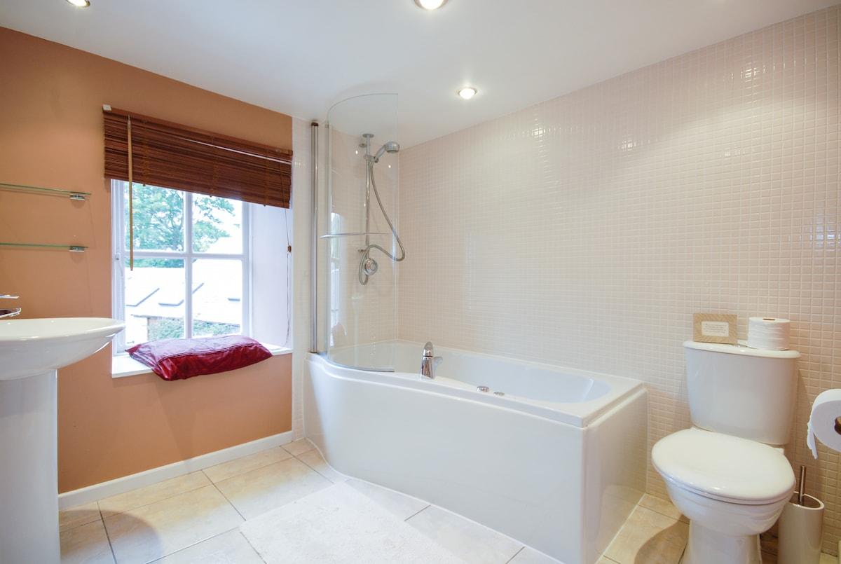 Family bathroom with jacuzzi bath. Beautiful views onto Lomond Hills.