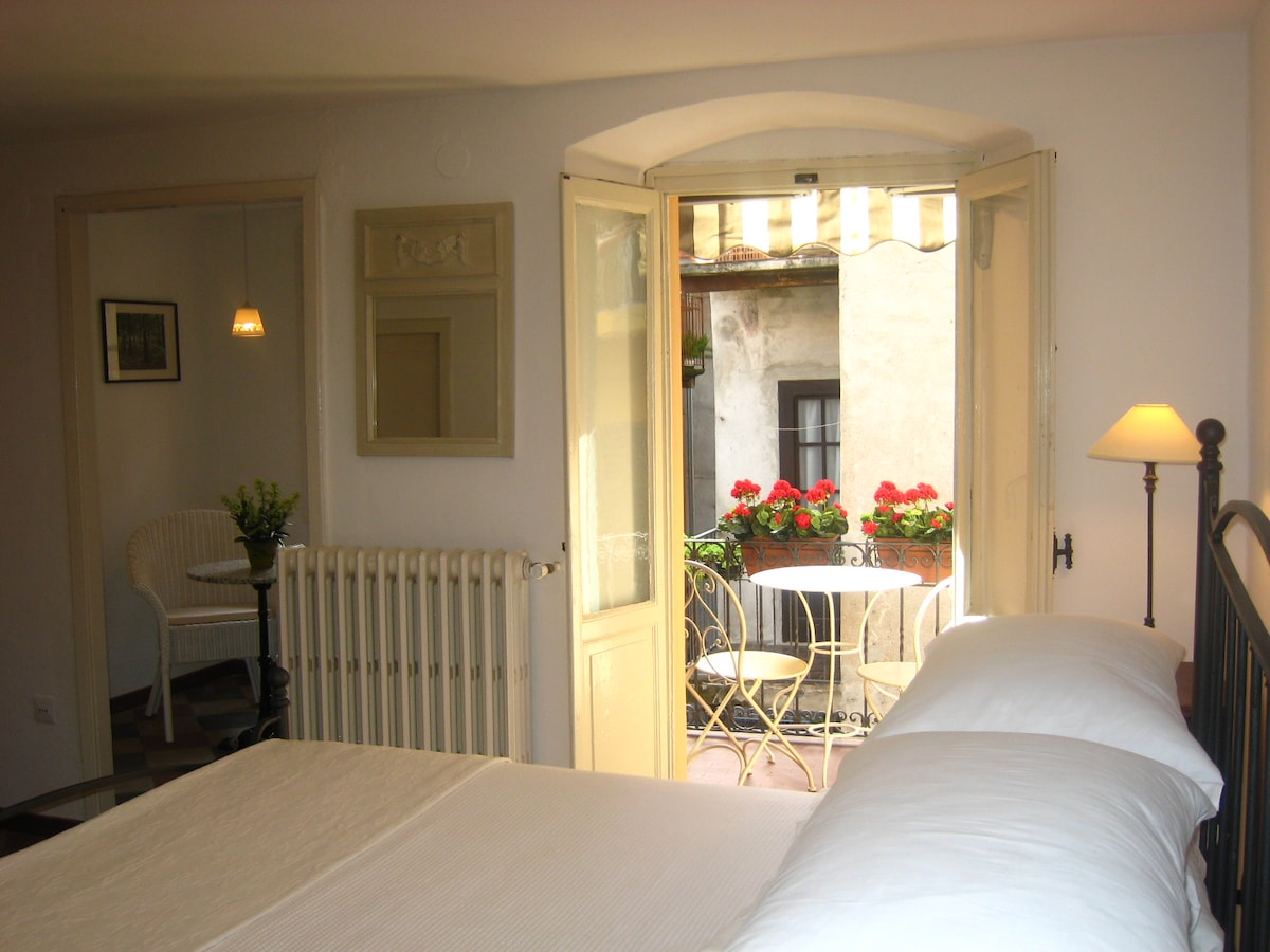 The master bedroom with balcony and private sitting room offers comfort in a romantic setting