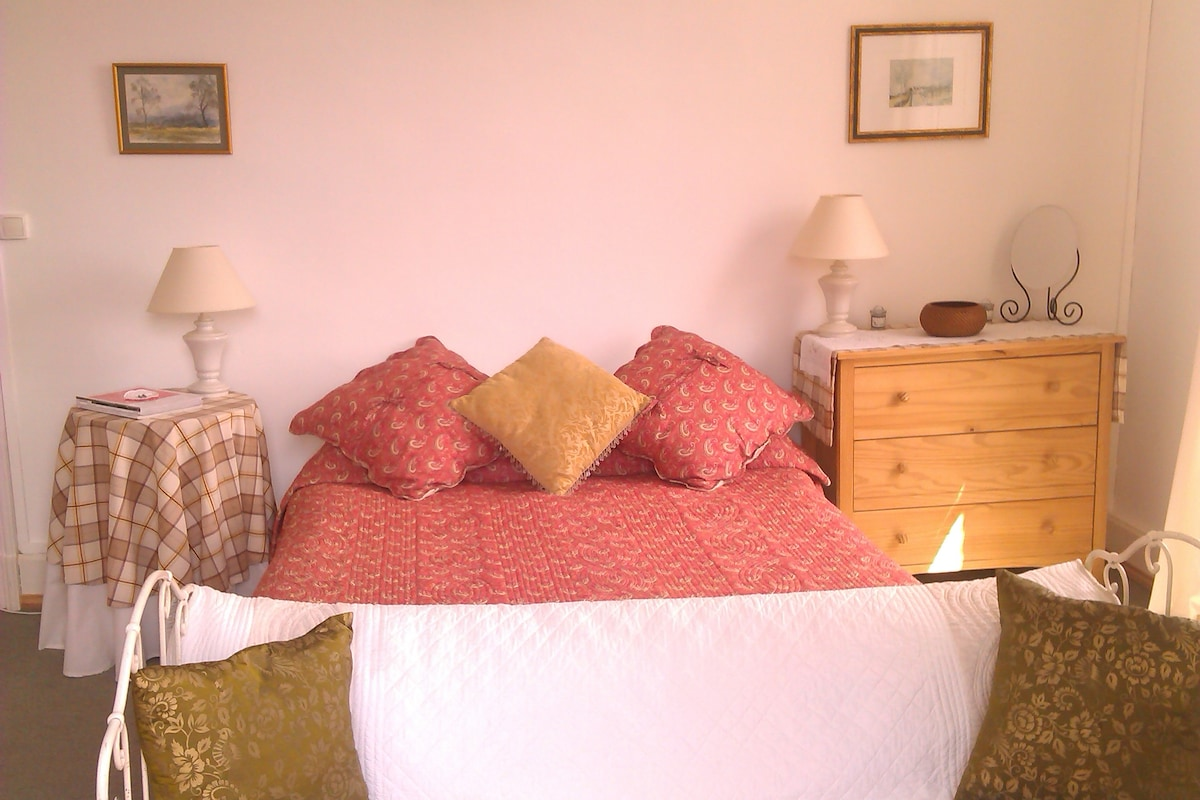 There is a daybed/sofa in the room and ample storage for clothes and cases.