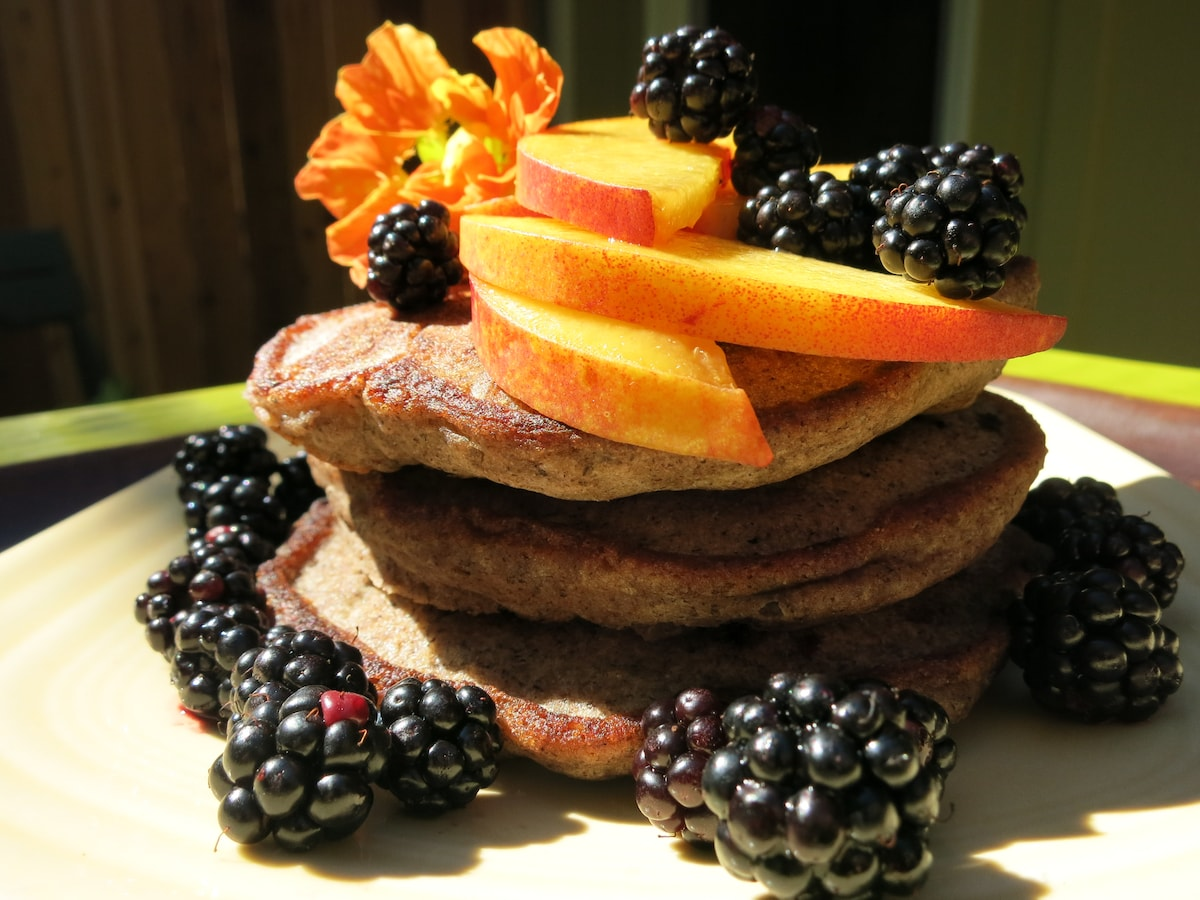Gluten-free blueberry pancakes with fresh blackberries and nectarine.