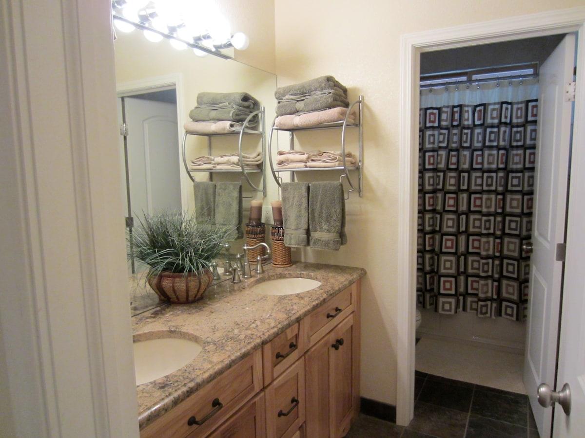 Downstairs bathroom has double sinks and bath tub/shower.