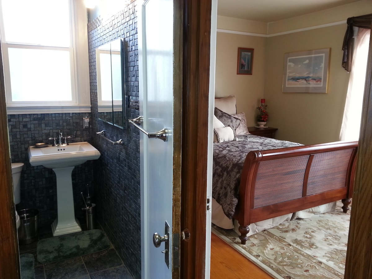 Bedroom #1 with partial view of adjacent bathroom