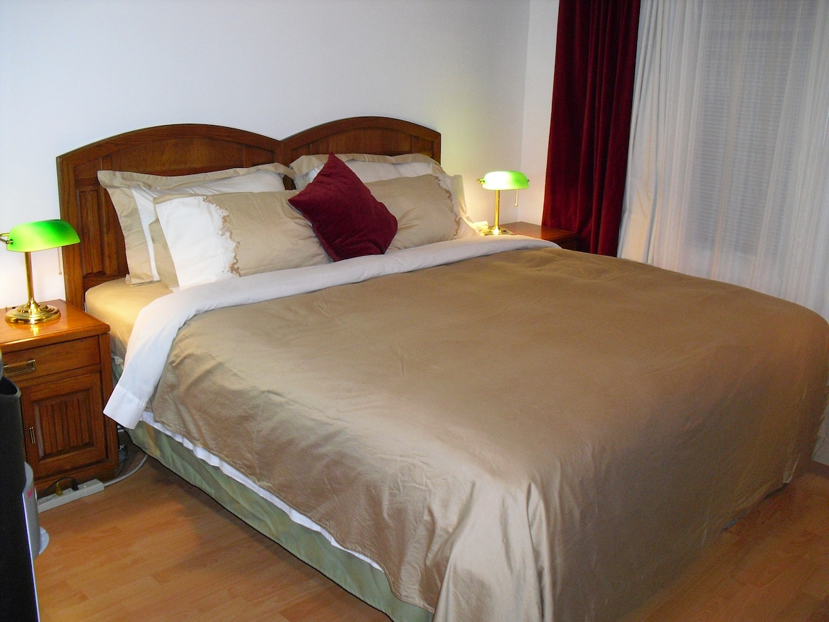 Large, comfortable King size bed with fresh, clean and crisp top quality bed sheets.