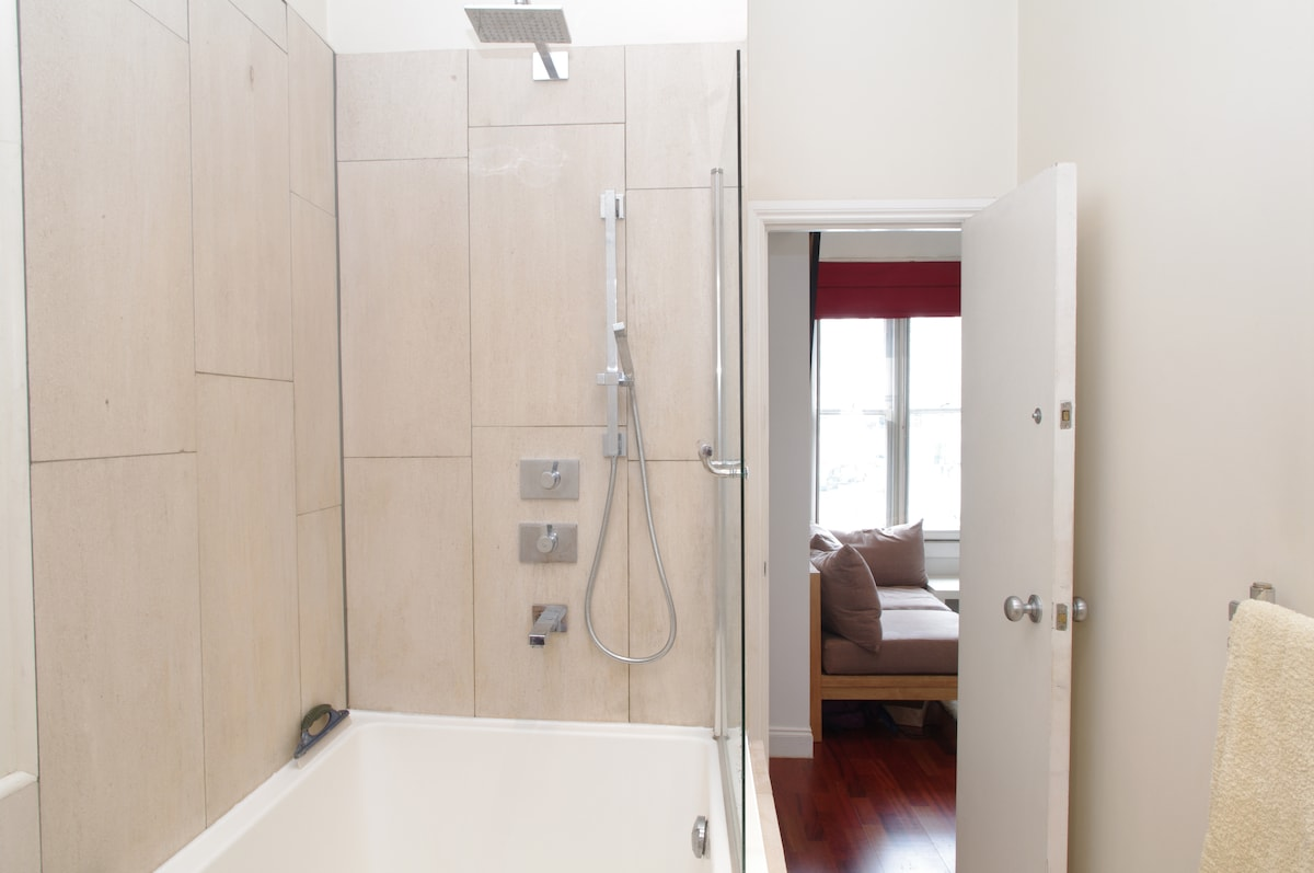 Our stone-tiled bathroom in a lovely flat in Central London