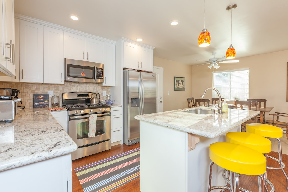 Open plan with all updated stainless kitchen, dinning and living room