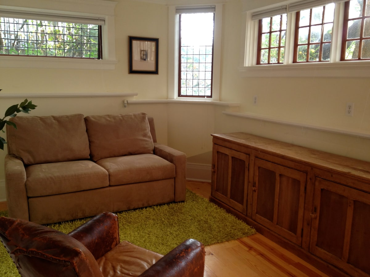 Main room with sofa closed - leaded glass windows