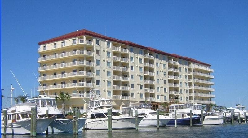 Picture of the marina with the condo in the background.