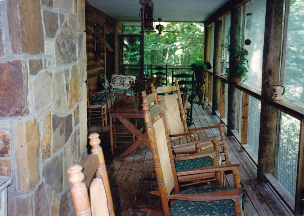 Rock away the hours right over the river on the screened in deck that runs the entire length of the house. Note the antique picnic table behind the rocking chairs, where you can enjoy any meal. It's also the ideal place to read.