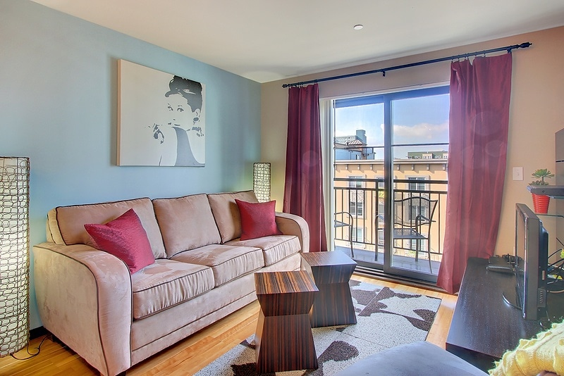 Living Room with HDTV, Queen Sized Sleeper Sofa and Balcony with City Views!