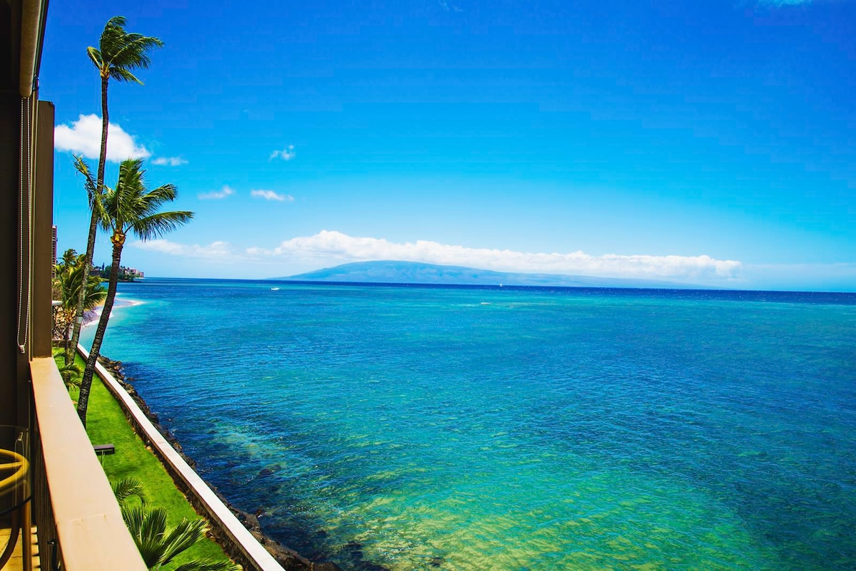 This is the unobstructed ocean view from the Lanai!  You can see the sea wall less than 15 feet away!