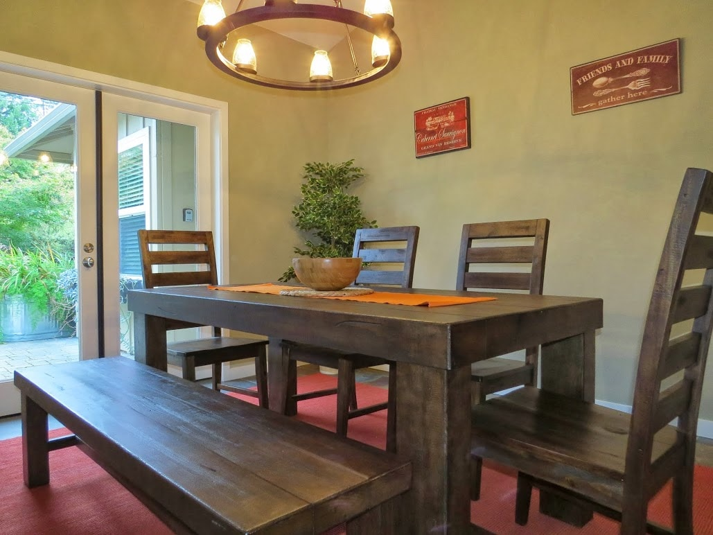 Dining room with wonderful lighting and doors to garden