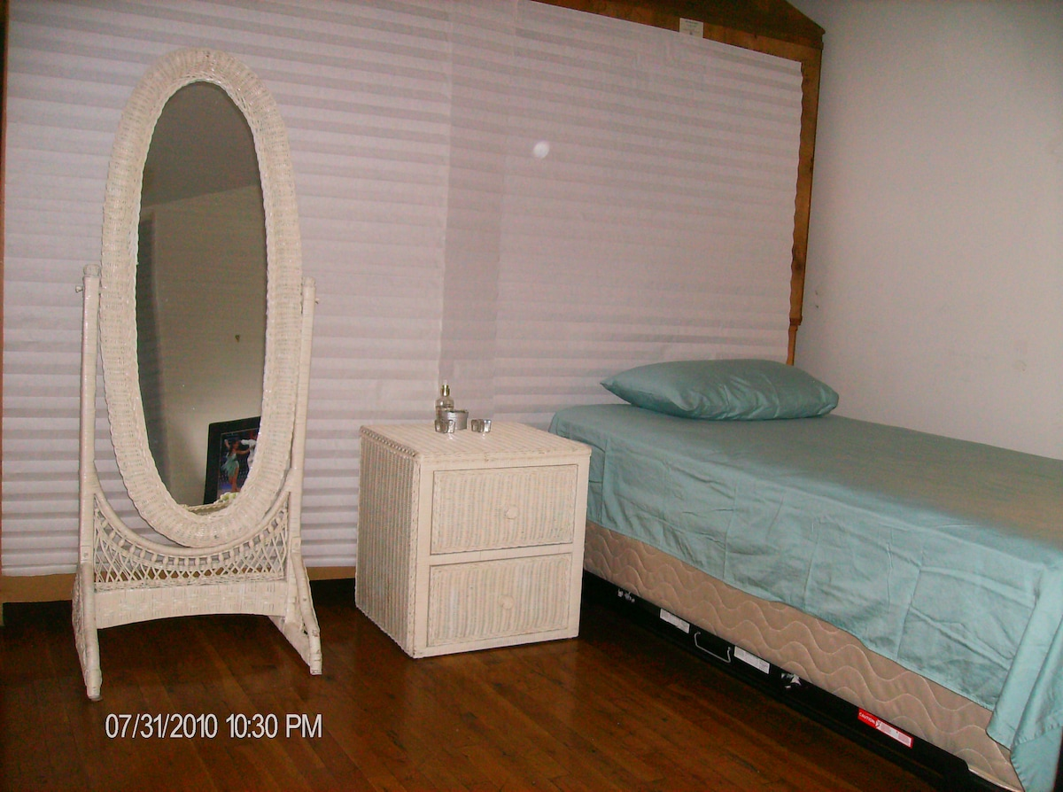 New twin bed with 2nd twin bed underneath. This room is spacious when one bed is used