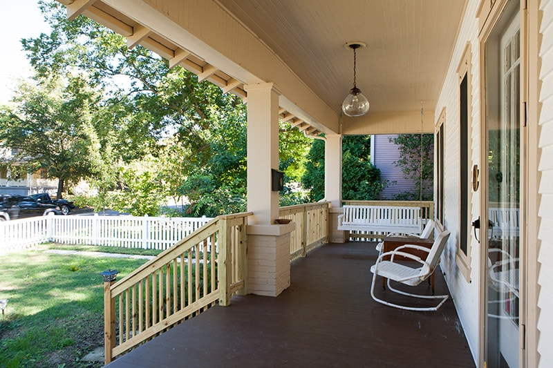 Classic Southern front porch with bench swing and rocking chairs