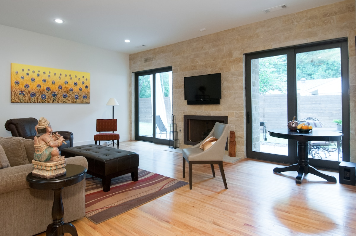 Living room with comfortable seating, fireplace and cable TV.
