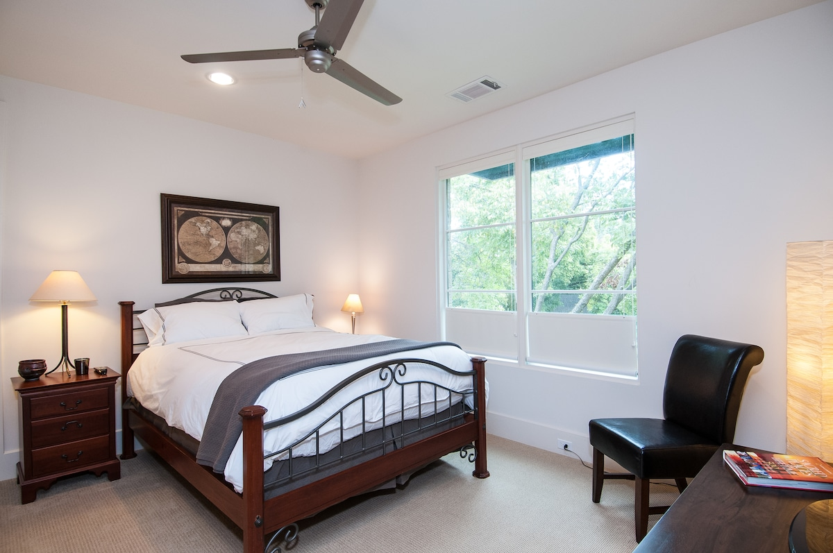 Relax in your upstairs bedroom suite including a comfortable desk, en-suite bath, walk-in closets and plenty of windows.