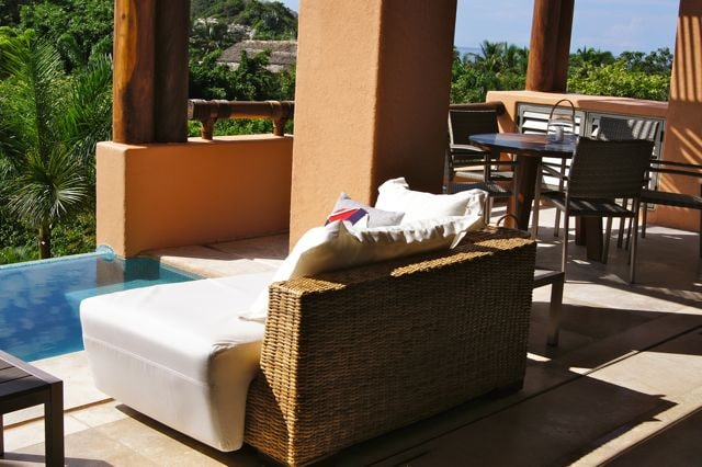 At the terrace there is a small pool and outdoor sofas an round table.