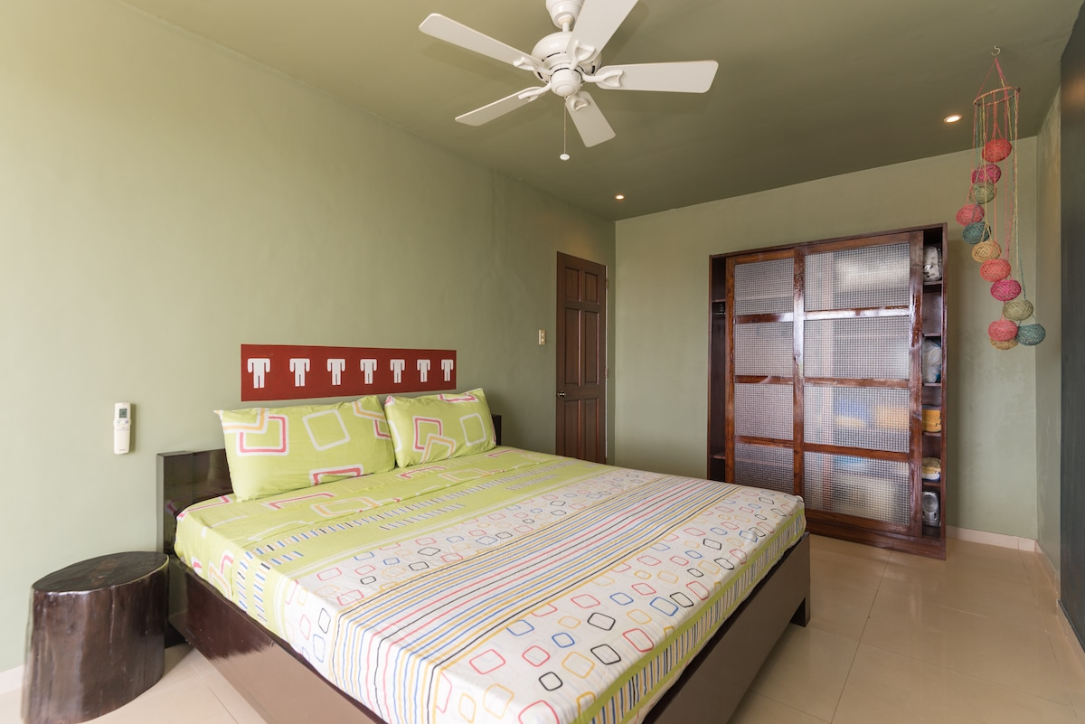 Spacious king size bed and mattress with dimmer lights, ceiling fan, remote controlled air-conditioning, armoire with built in safe box big enough for laptop, and sea view.