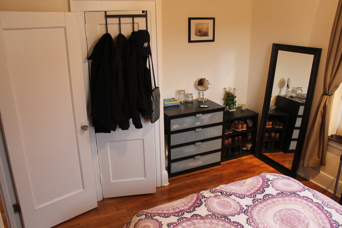 Bedroom has full-length wall mirror and closet space
