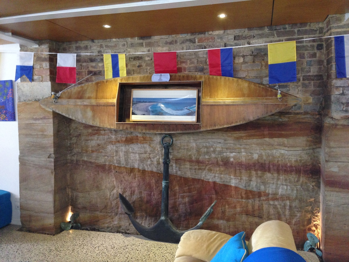 Our Bondi sandstone with the timber kayak built in 1971