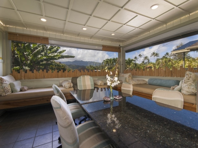 Enter into the spacious dining & lounging Lanai...great view of the mountains & sometimes Waterfalls