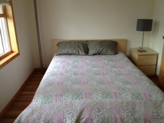 Queen size bed with night stand and table lamp. Hi speed  wi fi service.