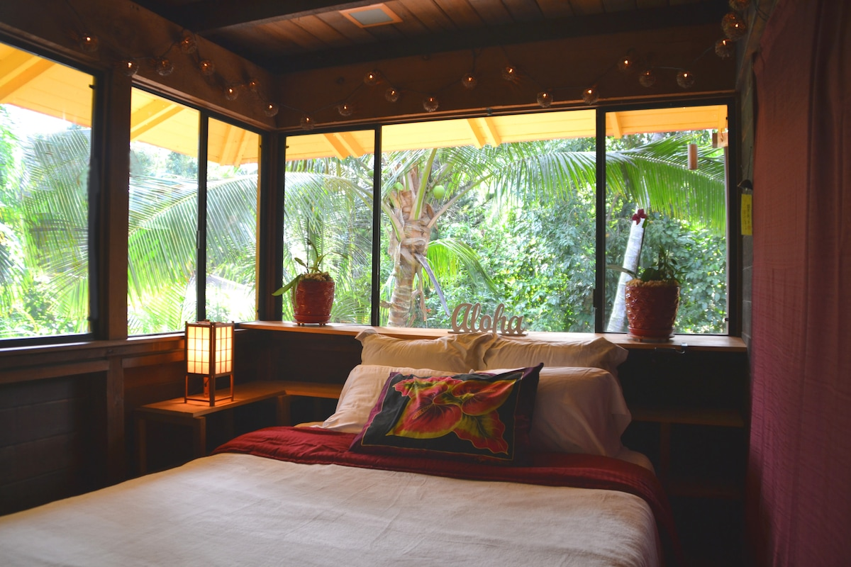 Surrounded by palm trees and coconut trees right outside your bedroom window