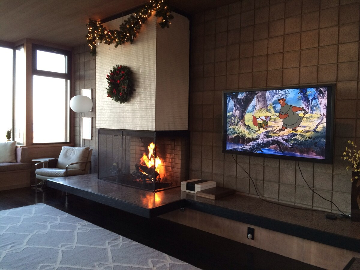 Living room with a fireplace and TV