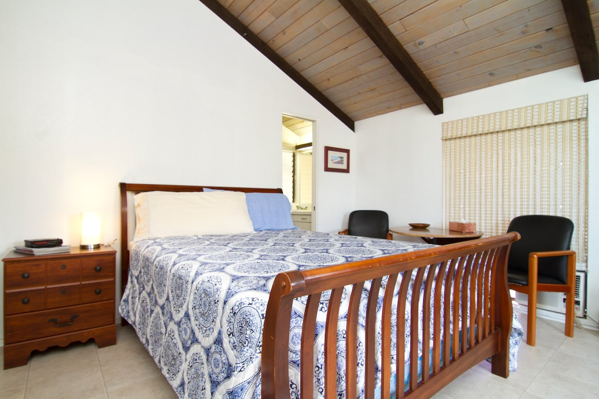 Balcony bedroom with queen bed.  The bathroom is accessible from within room.